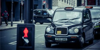 a-line-of-black-cab-taxis-at-a-taxi-rank
