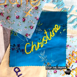 a-square-of-fabric-with-the-name-christine-stitched-in-the-middle