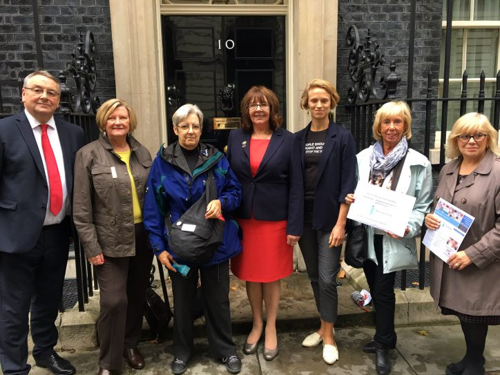 representatives-from-stop-the-traffik-and-soroptimist-international-northern-england-stand-outside-the-door-of-10-downing-street