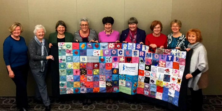 members-of-soroptimist-international-northern-england-hold-up-their-global-blanket